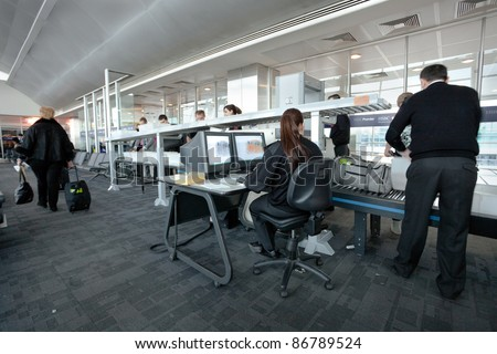 ISTANBULE - MARCH 22: Ataturk airport security staff check passenger bags at gate on March 22, 2011 in  Istanbul, Turkey. Ataturk is a major international airport in Turkey, located on European side, it opened in 1924. - stock photo