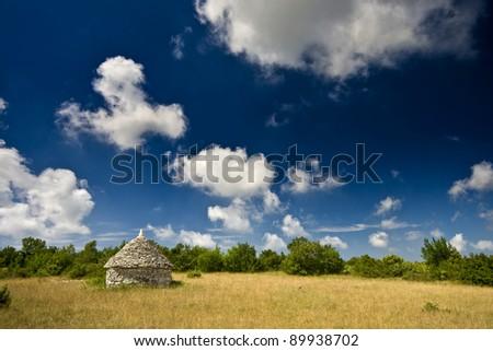 Istrian kazun under the white clouds - stock photo