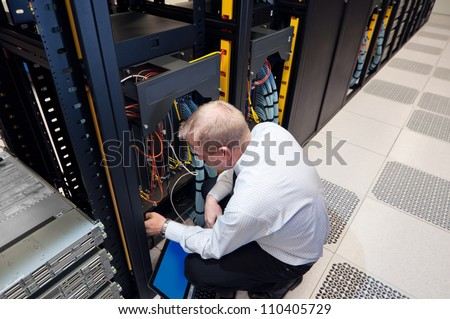 IT administrator installing new network equipment.