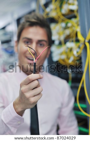 it business man in network server room have problems and looking for  disaster situation  solution - stock photo