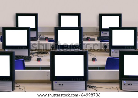 IT classroom with multiple blank computer screens to add your own message or image. - stock photo