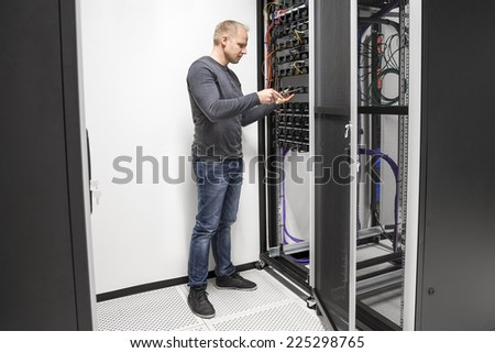 IT consultant building network rack in datacenter - stock photo