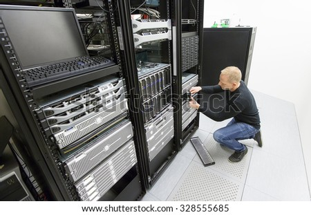 It consultant replace harddrive in datacenter - stock photo