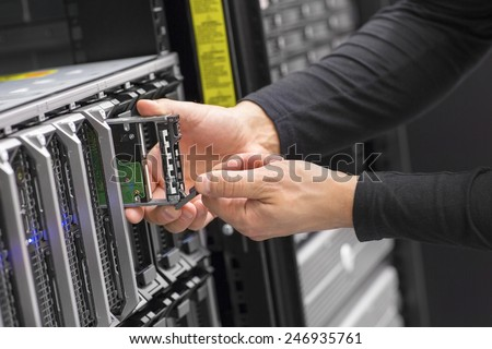 It consultant work on blade server in datacenter - stock photo