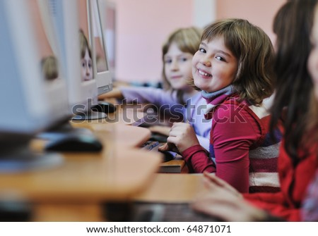 it education with children group  in school at computer science class learning leassons and practice typing - stock photo