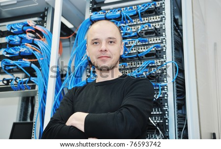 it engineer in network server room solving problems and give help and support - stock photo