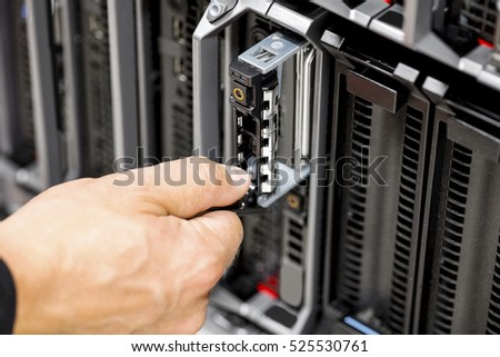 IT Engineer's Hands Repairing Server At Data Center