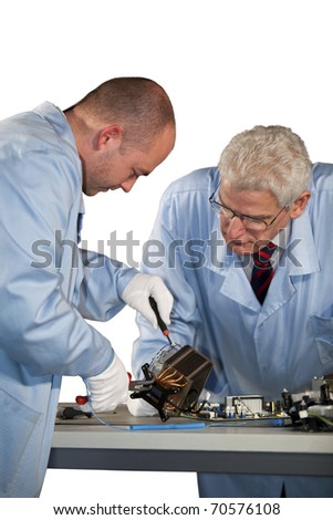 IT engineers repairing a CPU fan