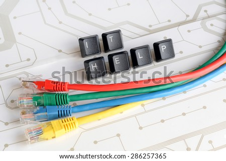 IT HELP, Assistance - Word IT HELP made of keyboard keys with colourful network cables on white circuit board background