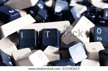 IT HELP,  Close-up on IT keys on Pile of Black and White Computer Keyboard Keys. Two visible Keys have letters IT.