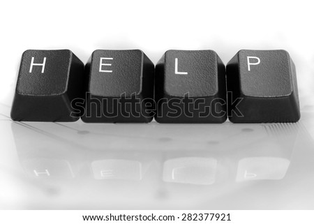 IT HELP, Four Black Keyboard keys with reflection on White Glass Background - stock photo
