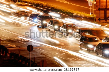 It is a cityscape of cars in the road with yellow blured light. - stock photo
