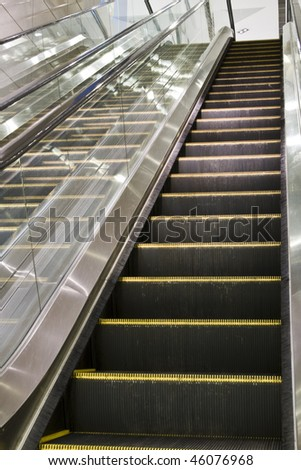 It is a close up with escalator in a building.