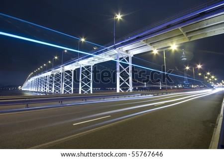 it is a highway under the bridge in macau - stock photo