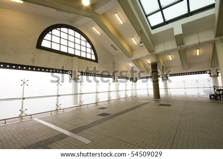 it is a indoor area of ferry habour,but many young use it for dance in hong kong - stock photo