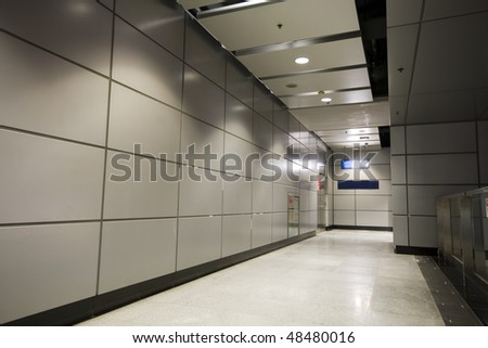 It is a long passageway in building - stock photo