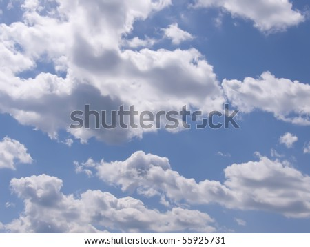 It is a lot of clouds against the dark blue sky in a sunny day - stock photo