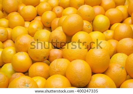 it is a lot of oranges and tangerines - stock photo