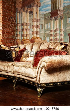It is a lot of pillows on a beautiful and fashionable couch - stock photo