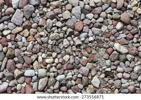 It is a lot of simple granite cobble-stones the top view background - stock photo
