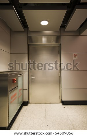 it is a private steel door in a building - stock photo