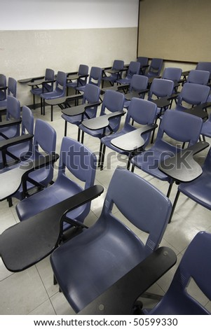 It is a shot of empty classroom - stock photo