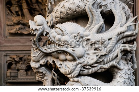 It is a stone carving of Taiwan. The stone dragon was carved in pillars. - stock photo
