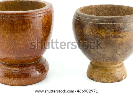 It is a wooden mortar and mortar on old wooden white background.