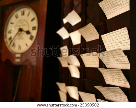 It is an old school time clock with cards and a classic grandfather clock.