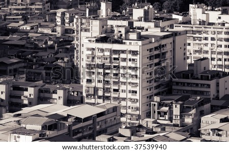 It is black and white cityscape of apartment and buildings.