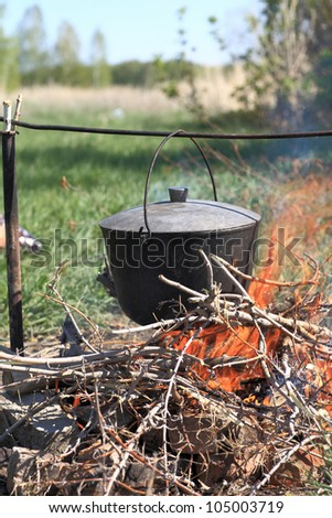 It is cauldron on picnic in summer - stock photo