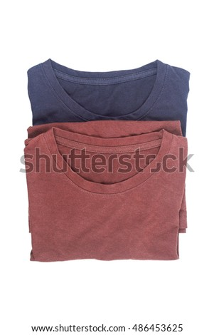 it is folding cotton brown and blue T-shirt isolated on white.