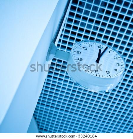 It is 5 minutes past twelve, metro station's clock - stock photo