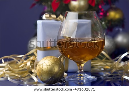 It is moment of Christmas or Happy New Year eve where someone is at home having some drink chilling out, listening Christmas songs ,making Christmas gifts and decorating with Christmas decoration.