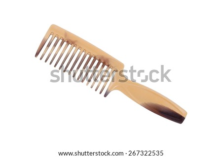It is Plastic comb isolated on white. - stock photo