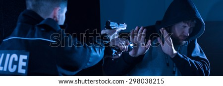 It is police officer's duty to catch a criminal - stock photo