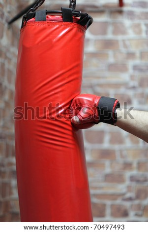 It is punching bag exercises in cellar - stock photo
