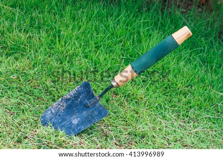 It is Shovel on green grass field. - stock photo