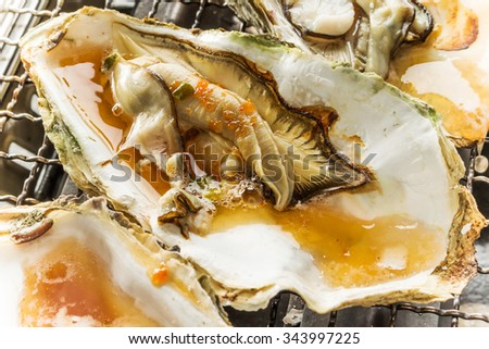It is soy sauce to the oyster which I roasted - stock photo
