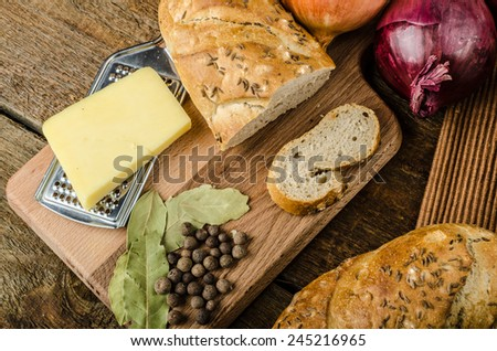 It is the French onion soup with baked toast with cheese on top, rustic pastry - stock photo