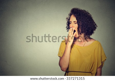 It is too early for meeting. Closeup portrait sleepy young woman with wide open mouth yawning eyes closed looking bored isolated grey wall background. Face expression emotion body language - stock photo