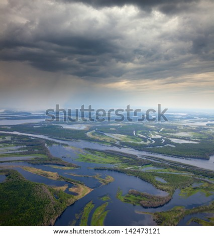 It is top view the place of flood of  river in forest during spring day. - stock photo