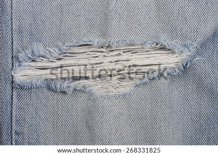 It is Torn on jeans texture for pattern. - stock photo
