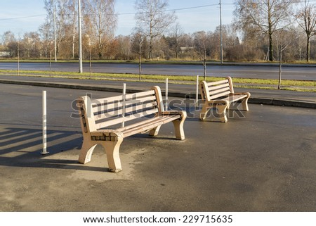 It is wo wooden benches in the Park - stock photo