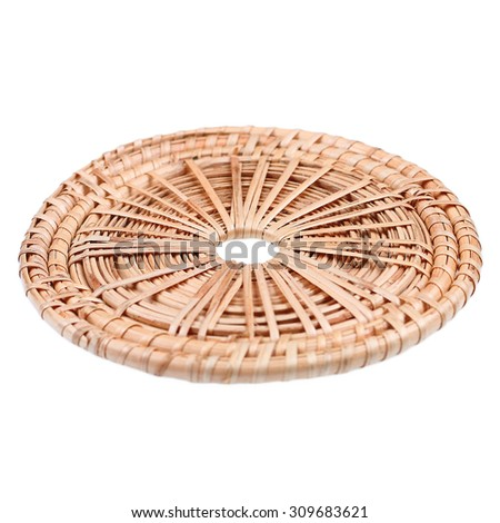 It is Woven rattan coaster isolated on white. - stock photo