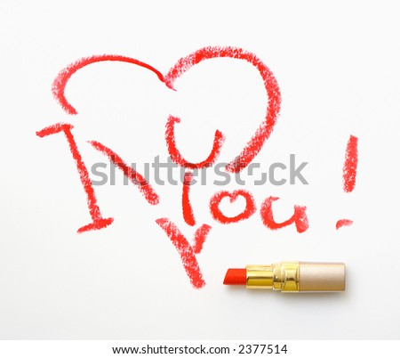 It's an 'I love you!' message written on a sheet of paper with the red lipstick. - stock photo