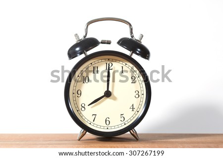 It's eight o'clock already. Time to wake up and hurry. An image of a retro clock showing 08:00 am or pm.