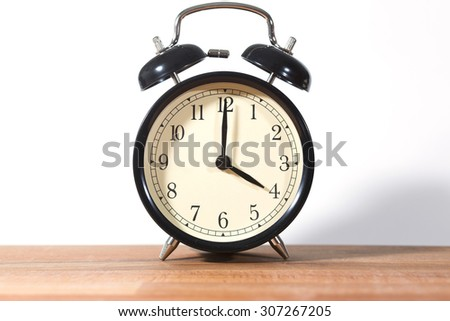 It's four o'clock already. Time to wake up and hurry. An image of a retro clock showing 04:00 am or pm - stock photo