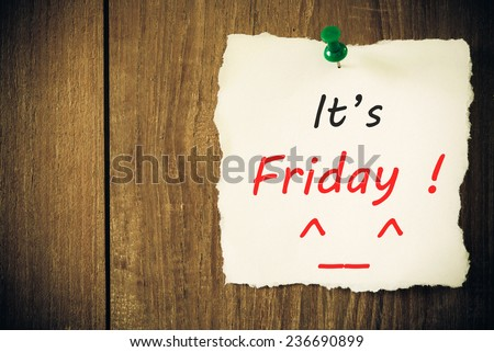 It's Friday - Hand writing text on a piece of paper on wood background - stock photo