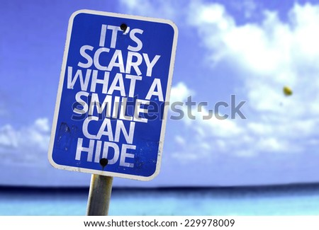 It's Scary What a Smile Can Hide sign with a beach on background